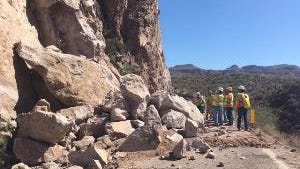 Crews examine rocks that were blown from the side of a mountain along State Route 88 as part of a $6.5 million improvement project.
