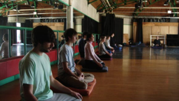 Contemplative studies students at Brown meditate as part of first-person learning in Ashamu Dance Studio. (Matthew Sacchet)