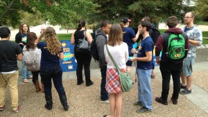 Jenny Klouse, InterVarsity area director, speaks with students at Sonoma State.