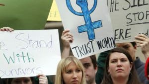 Students at the University of North Carolina protest in March 2013 the school's handling of sexual assault cases.