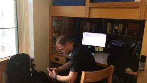 USNA sophomore Matt Sensenig checks his phone in his room at Bancroft Hall.