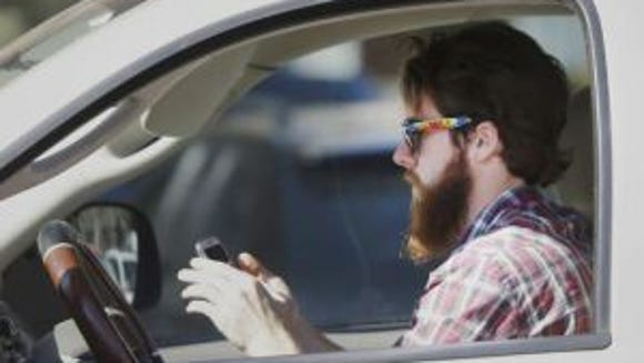 A new survey says that 18% of people admit that they cannot resist the urge to text while driving. (Photo: LM Otero, AP)