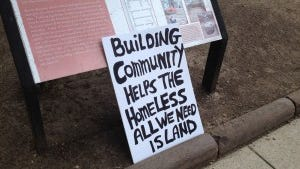 A sign that was carried by homeless advocates who rallied at the Statehouse on Monday, Aug. 18, 2014. (Bob Jordan photo)