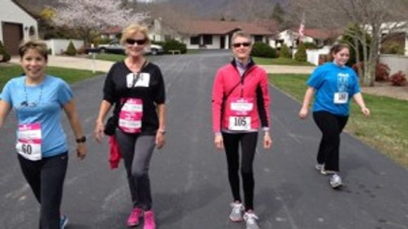 Some 200 runners and walkers took part in Sunday's Conquer A Cove 5K.