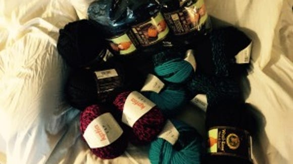The solid black yarn, including the 3 skeins in that plastic bag, are the Wool Ease Thick & Quick I bought to go with the Katia yarn, which is black with magenta or turquoise.