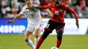 United States defender Christie Rampone (left) pressures Trinidad and Tobago's Tasha St. Louis during the first half on Oct 15 in Kansas City. (AP Photo/Colin E. Braley)