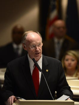 Gov. Robert Bentley peaks during a joint session of the Alabama Legislature held in honor of Military Appreciation Day on Thursday February 6, 2014 at the Alabama Statehouse in Montgomery, Ala.