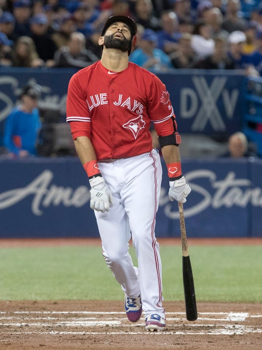 Toronto Blue Jays' Jose Bautista reacts after striking out against the Tampa Bay Rays in the third inning of a baseball game in Toronto, Sunday, April 30, 2017. (Fred Thornhill/The Canadian Press via AP)