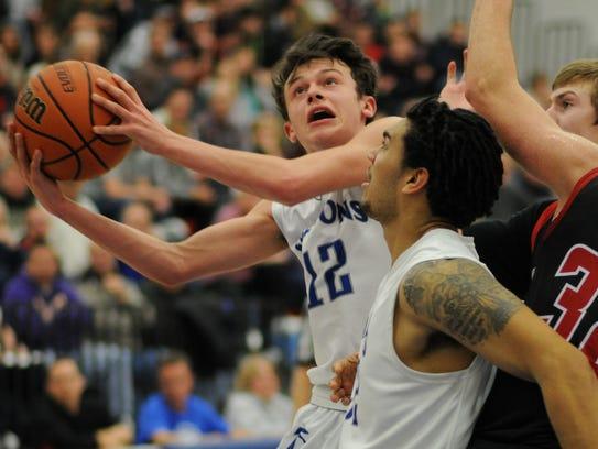Cedar Crest sophomore Dylan Miller looks to the basket