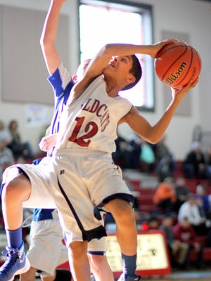 Jordan Caballero (12) glides toward the basket, draped by a La Plata Broncos defender during Wednesday's Silver City-Deming rivalry basketball game. The seventh graders from Silver City's La Plata Junior High and Deming's Red Mountain Middle School have been challenging each other since what seems like the dawn of time. This time, Caballero and his Wildcat teammates picked up the victory. The teams prepare now for the post-season tournament on Saturday in Hatch Valley.