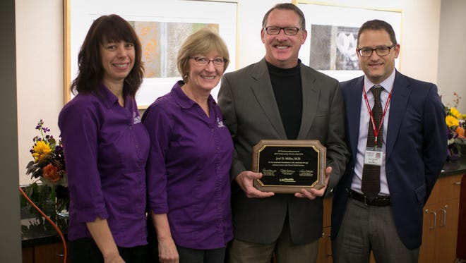 Pictured from left are Angie Olson, Bev Beal Loeck, Joel Miller and Peter Newcomer, at a recent UW Health awards event.