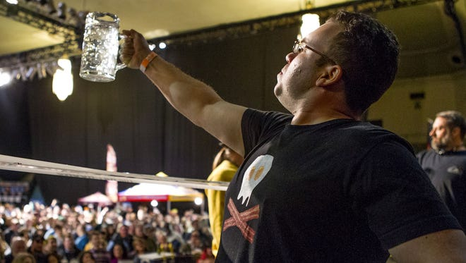 Adam Velez of Middlesex tries his luck at The WRAT's Beer Muscles Competition during the 2015 Asbury Park Beerfest.