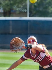 New Mexico State's third baseman Emma Adams lunges