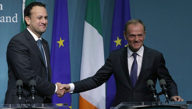 President of the European Council, Donald Tusk, right, shakes hands with Irish Prime Minister Leo Varadkar at a press conference.