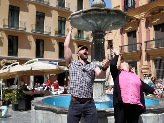 """Jake Harrison was on a free walking tour of Malaga, Spain, when this lady tried to toss a coin into the fountain and missed. Not wanting her to miss her wish, Harrison left the group (in the background) and grabbed her rolling coin. """"I took the coin back to her, and we both tossed a coin and made a wishes together,"""" he says."""