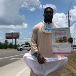 Titans' Brian Orakpo wears big baby costume on side of the highway