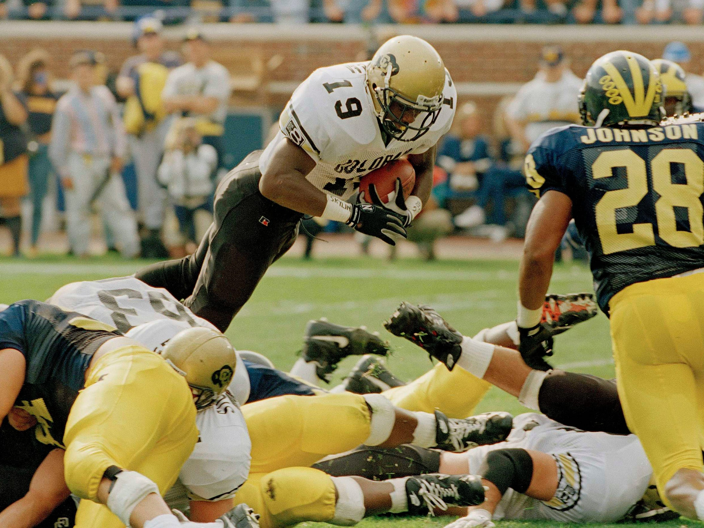 """Salaam dives for a touchdown in the 1994 """"Miracle in"""