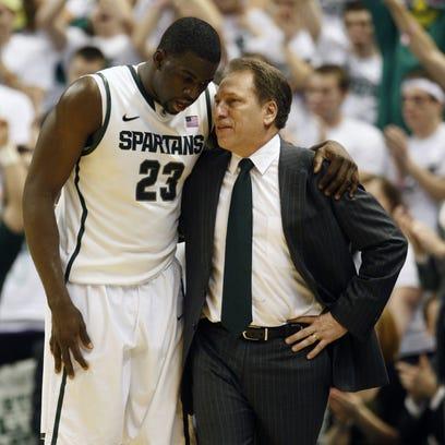 Michigan State's Draymond Green and Tom Izzo talk in 2012.