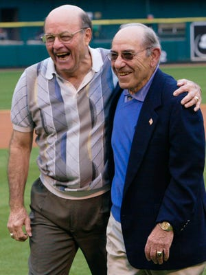 Baseball Hall of Famers Joe Garagiola (left) and Yogi Berra share a moment after throwing out the first pitch before a game between the Pittsburgh Pirates and the St. Louis Cardinals in St. Louis on Saturday, May 31, 2003.