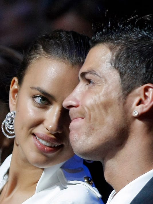 FILE - This is a Thursday, Aug. 30, 2012 file photo of Real Madrid's Portuguese forward Cristiano Ronaldo , right, with with his girlfriend, Russian top  model Irina Shayk, during the UEFA Champions League draw in Monaco. Cristiano Ronaldo confirmed Tuesday Jan. 20, 2015 that he has broken up with his longtime girlfriend, Russian model Irina Shayk.   (AP Photo/Claude Paris)