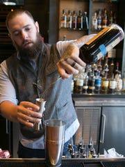 Head bartender Phil Clark of Blue Hound Kitchen and