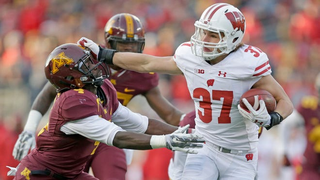 Running back Garrett Groshek and his UW teammates capped off a perfect regular season by routing Minnesota on Saturday in Minneapolis.