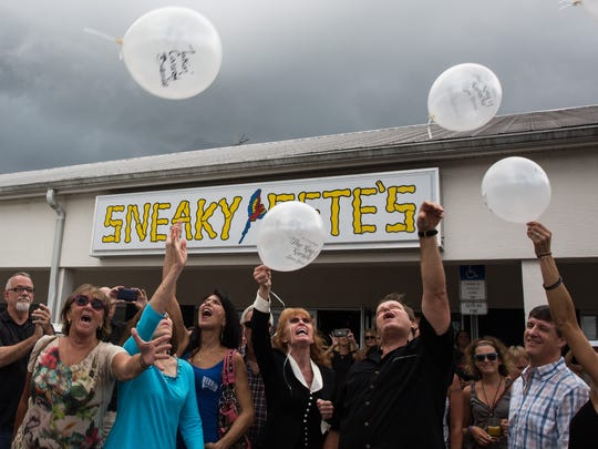 The crowd releases balloons during a celebration of life for Lynn Brown at Sneaky Pete's in Bonita Springs on Aug. 28, 2016. Brown, who attended karaoke at the bar every Monday and Tuesday, was killed in an apparent hit-and-run earlier this month.