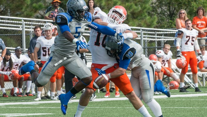 Faulkner's Dennis Thames (#5) and Keylan Smith (#18) shut down a passing play. Faulkner University shut out Georgetown College at home on Saturday, Sept. 26, 2015, in Montgomery. Faulkner won 44-0.