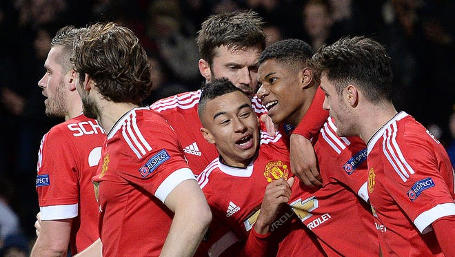 Manchester United's English striker Marcus Rashford (2R) celebrates scoring his team's third goal during the UEFA Europa League round of 32, second leg football match between Manchester United and and FC Midtjylland at Old Trafford in Manchester, north west England.