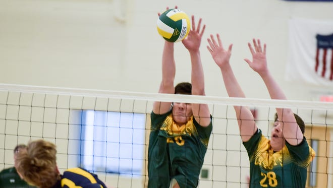 RBC's Emmett McNamara (26) and Anthony Destafano (28) block the attempt by Marlboro's Jared Billig (23). Marlboro was at Red Bank Catholic in Red Bank, NJ, for boys volleyball on Wednesday, April 13, 2016. / Russ DeSantis for the Asbury Park Press / Slug:ASB 0414 HS Roundup