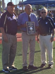 Fred Cole (center) receives his Hall of Fame plaque from Mike Stang (left) and Stan Lipson.