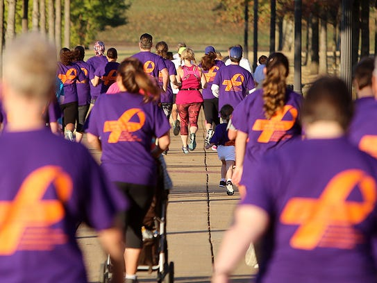 People take part in a psoriasis awareness 5K on the