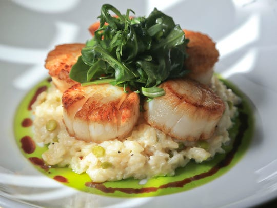 Georges Bank seared scallops with split pea risotto with basil oil and balsamic reduction from Brendon's Catch 23 and prepared by chef Ray Ramirez.