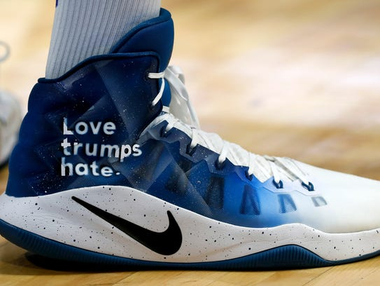 Karl-Anthony Town wore Love trumps hate on his shoes