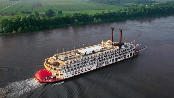 The American Queen steamboat sails on the Mississippi River complex.
