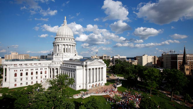 Under the measures, Wisconsin lawmakers would be able to draft bills in secret and hide their communications from the public.
