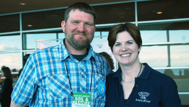 Tucker and Becky Gretebeck are Organic Valley farmers who transitioned their dairy herd to all grass-fed production a few years ago. They visited with consumers about how pleased there are with their herd's health during a Grass Up event in Madison last week.