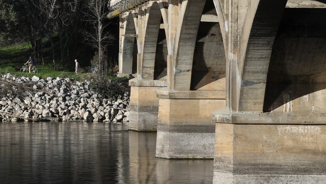 People walk and bike along the River Trail Wednesday. The city is proposing a safer route to be created from the Diestelhorst Bridge to downtown Redding.