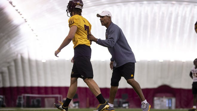 Head football coach Herm Edwards of the Arizona State Sun Devils speaks to freshman defensive back K.J. Jarrell during a practice at Arizona State University on Sunday, October 28, 2018 in Tempe, Arizona.