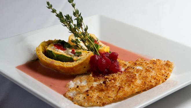 Parmesan and panko crusted winter fluke with a butternut squash, goat cheese, spinach and roasted pepper pinwheel and cranberry burre blanch at Serenity Cafe.