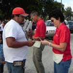 Nancy Solliday, right, vice president of advertising, joined a team of employees at The News-Press selling copies of the Thanksgiving Day newspaper from the paper's parking lot on Wednesday.