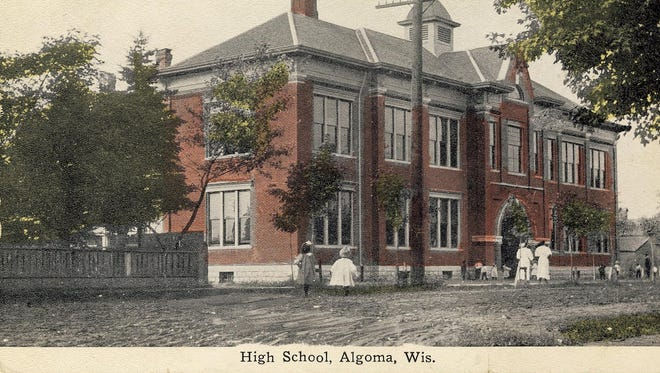 "The present Algoma Elementary School was built just behind this one, which was demolished in the mid-1930s. It housed grade school and high school students at the time the postcard was sent in 1917, along with an efficiently run school bank.  Established to give students actual business experiences and saving money, capital stock was $100 with ¾ of it sold before the bank's opening. Banking hours were late afternoons, when the bank was manned by directors and officers chosen from the student body. Surprisingly, the heaviest depositor was a kindergarten youngster; however, there were no deposits over $50.  The postcard comes from ""Yours Truly, from Kewaunee County'' by Virginia Feld Johnson, published in 2013, for sale online and available at Algoma Public Library. ""Yours Truly, from Kewaunee County,'' c. 2013 and available at Algoma Public Library."