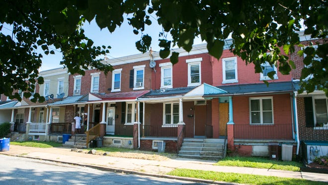 A trio of entrepreneurs with WilmInvest plan on buying distressed properties, like these along the 800 block of East 17th Street in Wilmington, and renovating them for supportive housing.
