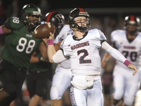 Haddonfield's quarterback Jay Foley throws a pass during the first quarter of Friday night's game against West Deptford.