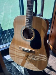 Guitar autographed by The Band Perry in Vanderbilt baseball coach Tim Corbin's office.