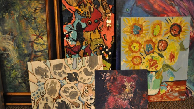 More than 50 paintings being housed at the Alexandria Zoo will be auctioned off Friday night during the zoo's Wild Night of Art fundraiser. The pieces were started by animals at the zoo and finished by local artists.