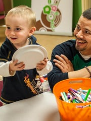 From left, Grady, 2, of Grand Isle enjoys crafts with his dad Leo Zambrano and brother Tommy, 6, during an open house for adoptive families at Lund in South Burlington on Wednesday, November 16, 2016.