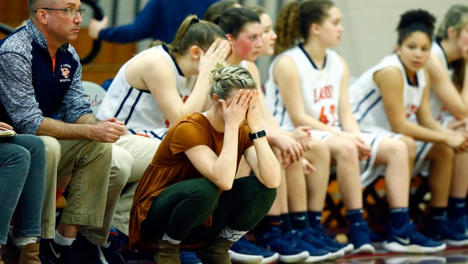 Dickson County girls basketball coach Catie Embry reacts during their Region 6-AAA semifinals game against Ravenwood on Monday at Franklin. Ravenwood won 53-45.