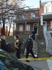 Police outside the home of Inga Young, who police said
