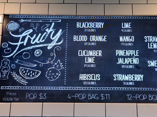 A menu screen above the counter at Steel City Pops, a gourmet Popsicle company that has stores throughout the south, which is opening a location in the former Wild and Woolly Video space at 1021 Bardstown Road. March 22, 2016